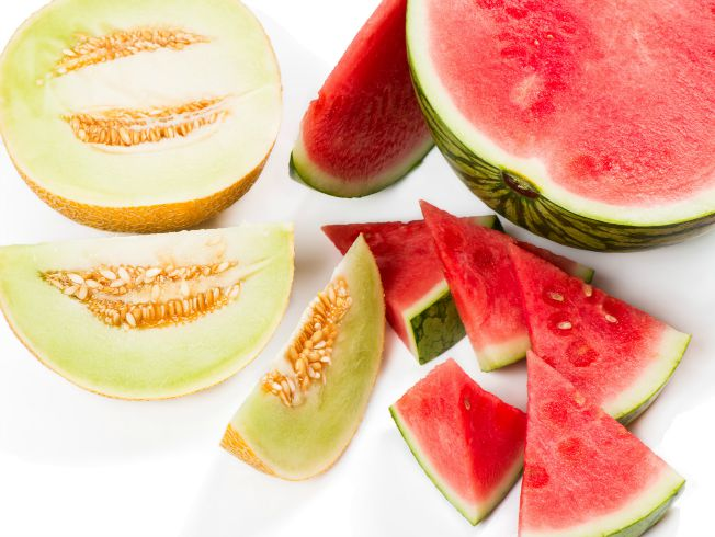 Watermelon and melon with a slices isolated on white background