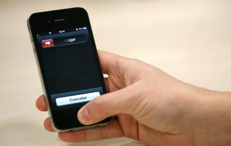 Pulsar sobre el botón de inicio del iPhone.
